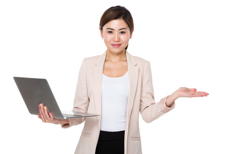 palm computer: Asian businesswoman use of the laptop computer and open hand palm