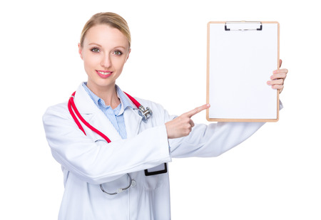 general pediatrician: Female doctor with finger point to clipboard Stock Photo