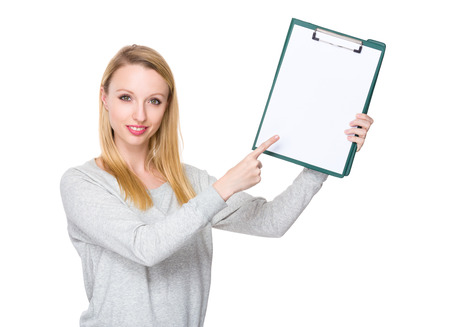 sweatsuit: Caucasian young woman finger point to clipboard