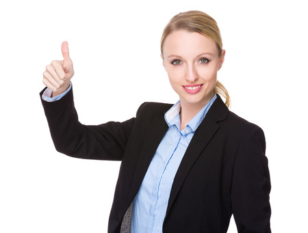 american banker: Young businesswoman with thumb up gesture Stock Photo