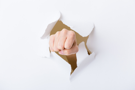 paper punch: Paper breakthough by woman punch