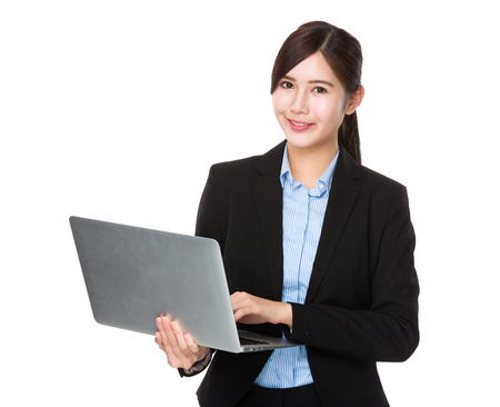 business suit: Businesswoman use of the laptop computer
