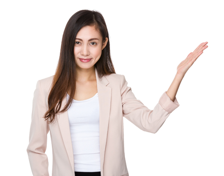 promoting: Asian businesswoman with hand promoting somehting Stock Photo