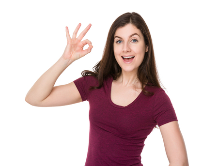 ok sign: Caucasian woman with ok sign gesture Stock Photo