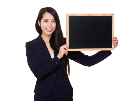 black board: Asian Businesswoman showing with chalkboard Stock Photo