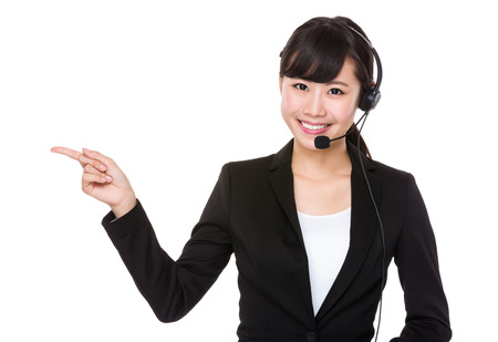 hotlink: Telemarketing concept, businesswoman with headset and finger pointing selling something Stock Photo