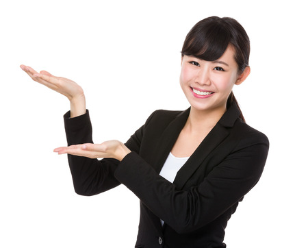 demonstrate: Asian Businesswoman showing with open hand palm Stock Photo