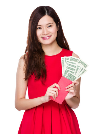 usd: Chinese Woman hold red pocket with USD