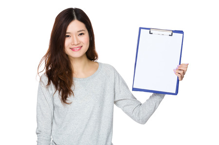 sweatsuit: Asian Woman show with clipboard Stock Photo
