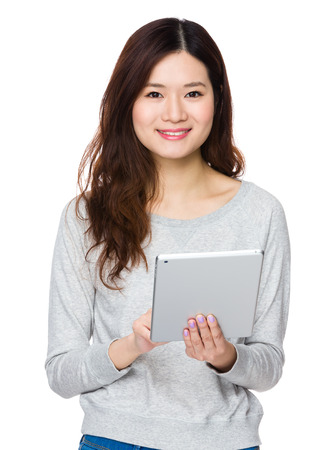 sweatsuit: Asian Woman use of the tablet pc