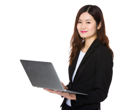 computer use: Asian businesswoman use of the notebook computer
