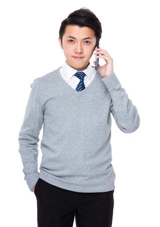 young executive: Asian businessman talk to cellphone Stock Photo