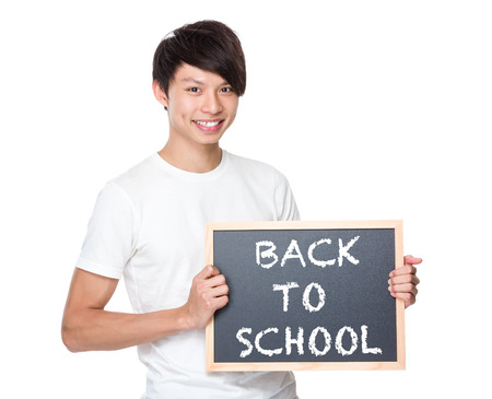 phrases: Young university student with blackboard showing phrases of back to school