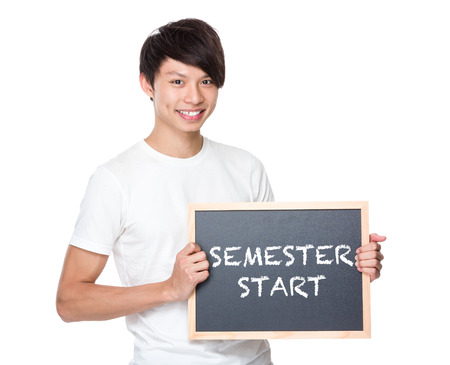 semester: Young university student with blackboard showing phrase of semester start