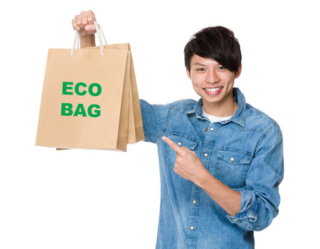 bring: Man finger point to shopping bag for showing phrase of eco bag Stock Photo