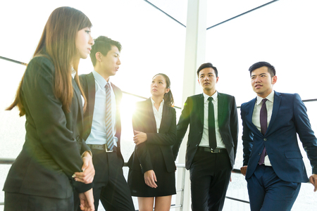 teammate: Group of business teammate standing at office