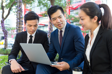 discuss: Group of business teammate discuss by using laptop computer