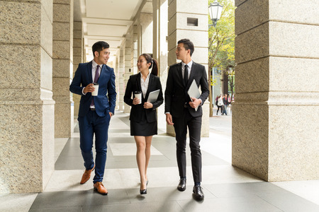 china people: Group of business people walking in the street