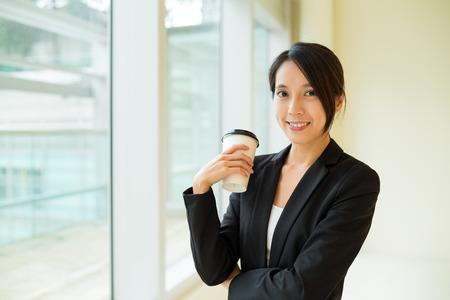 hot secretary: Businesswoman with her coffee cup Stock Photo