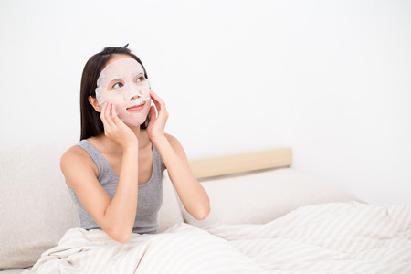 white sheet: Woman use of the paper mask