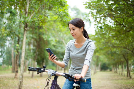 go for: Woman checking the routine when go for cycling