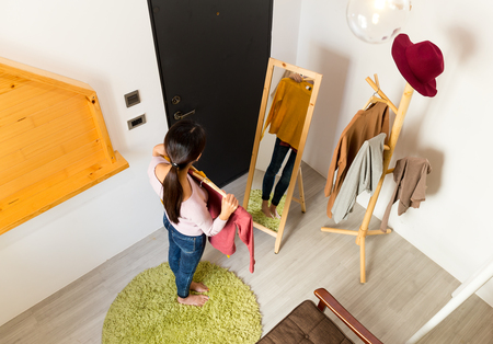 korean style house: Top view of woman wonder which clothes better Stock Photo