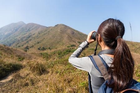 Asian Woman use of the binocular