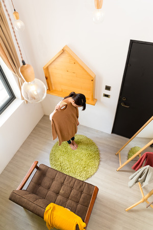 going out: Top view of woman choosing clothes for going out