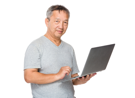 Old man learn to use of notebook computer photo