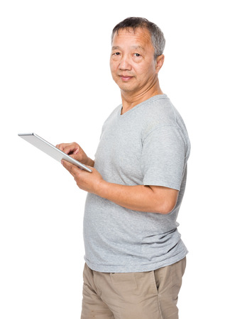 Mature man use of tablet computer photo