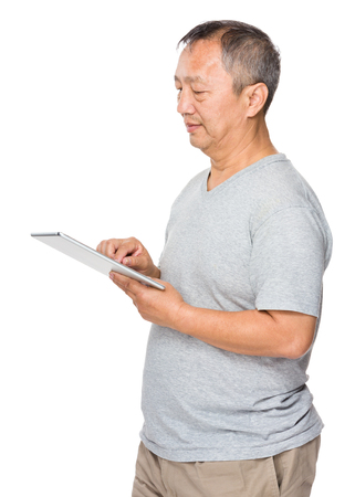 Mature man use of digital tablet photo