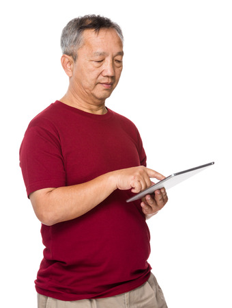 Asian old man use of digital tablet photo