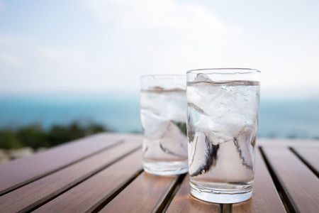 water garden: Glass of water at outdoor restaurant Stock Photo