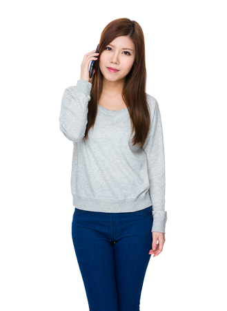 sweatsuit: Young Woman talk to cellphone