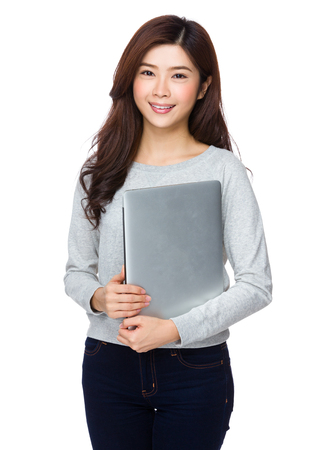 sweatsuit: Young Woman hold with laptop computer Stock Photo