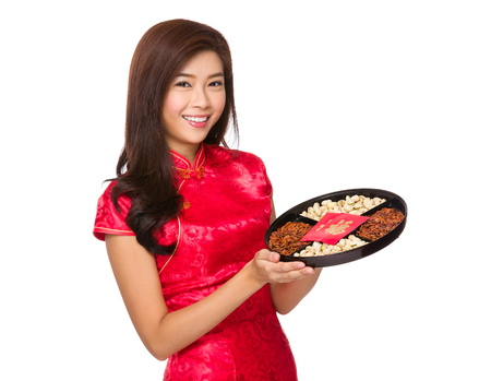 celebrate year: Woman with chinese gown hold with snack tray Stock Photo
