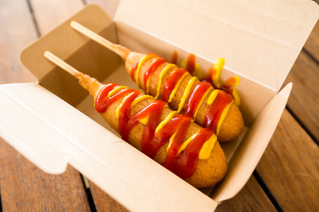 food state: Corn dog in paper box