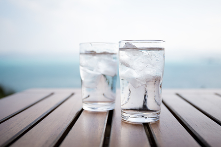 blue glass: Glass of water on a table in a restaurant Stock Photo