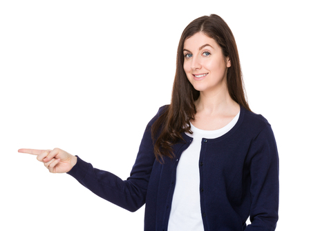 aside: Young woman with finger point aside
