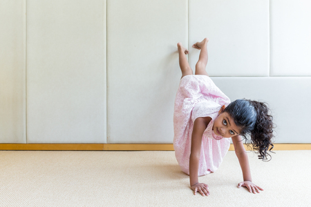 indonesian girl: Indian girl playing handstand at home