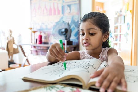 child drawing: Little girl drawing at home Stock Photo