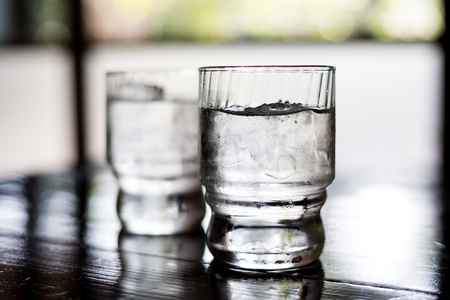 Glass of water on table in restaurant Stock Photo