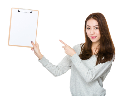 sweatsuit: Young woman finger point to clipboard