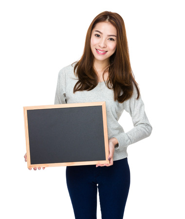 sweatsuit: Woman showing with chalkboard Stock Photo