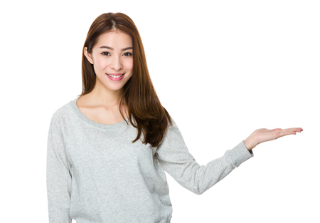 sweatsuit: Asian Young Woman with hand showing the blank sign
