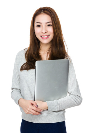 sweatsuit: Asian Woman hold with laptop computer Stock Photo