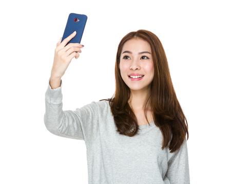 sweatsuit: Asian woman take selfie by mobile phone Stock Photo