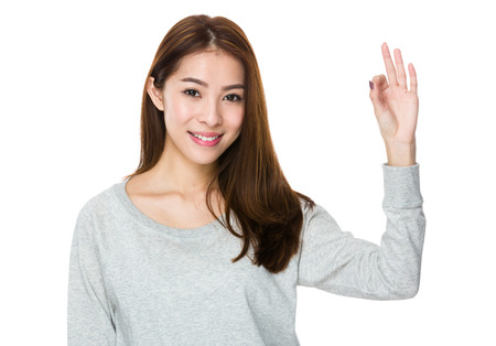 sweatsuit: Woman showing ok sign gesture