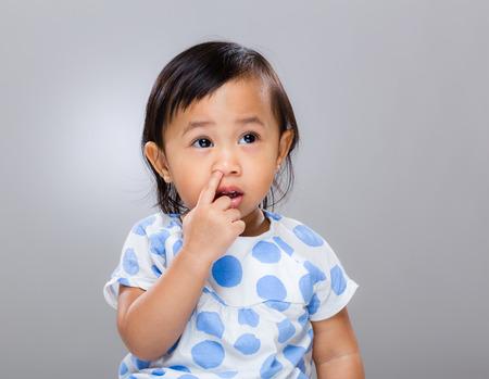 Baby girl pick nose