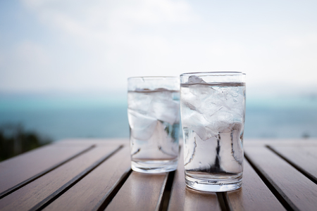 half and half: Glass of water at restaurant